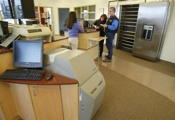 By TOM SMART, DESERET MORNING NEWS. A teller helps customers at Credit Union One March 5, 2004.